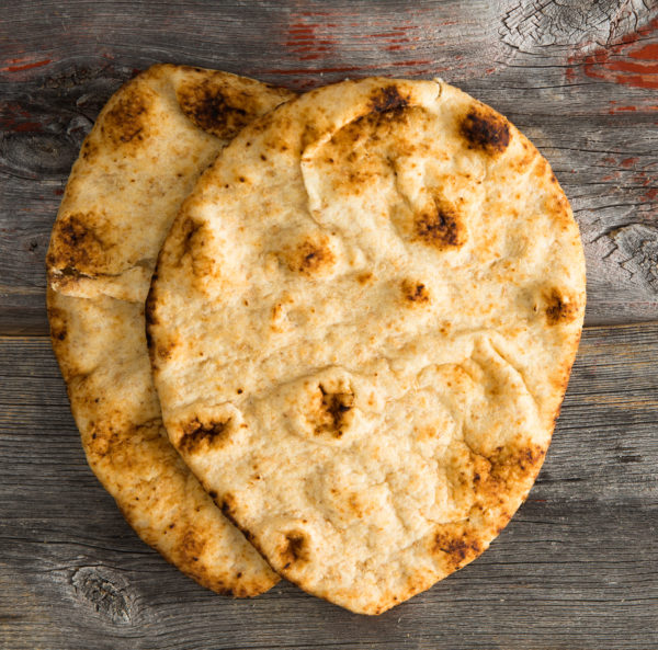 Simply delicious baked naan flatbreads on Picnic Table